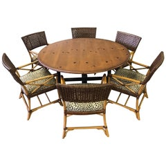 Woven Leather and Bamboo Dining Chairs with Round Wood Table