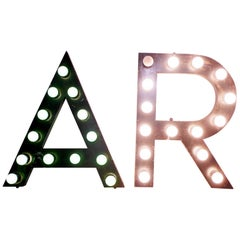 Painted Tin Letters Rewired with Bulbs Used for a Theater Sign