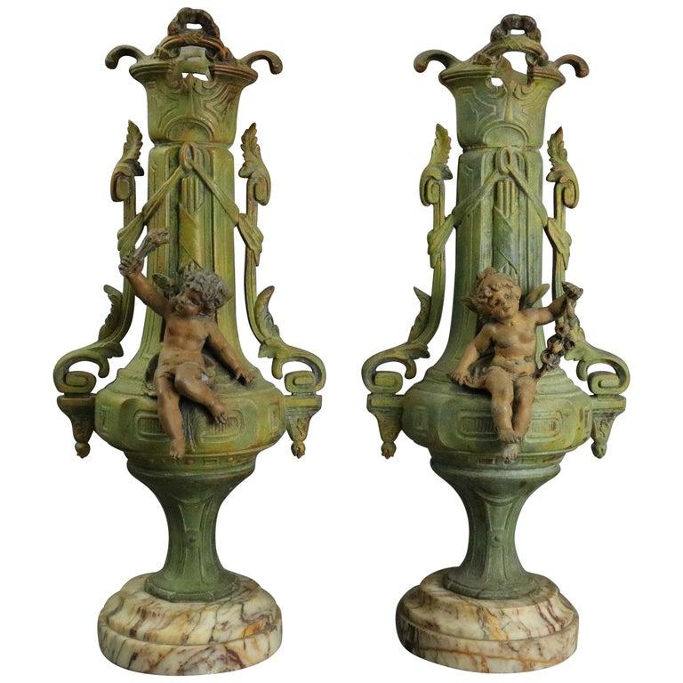 Antique Classical Greek Verdigris Metal and Marble Figural Cherub Urns For Sale