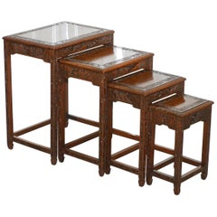 Chinese Export circa 1930s Nest of Four Tables Heavily Carved All over in Teak