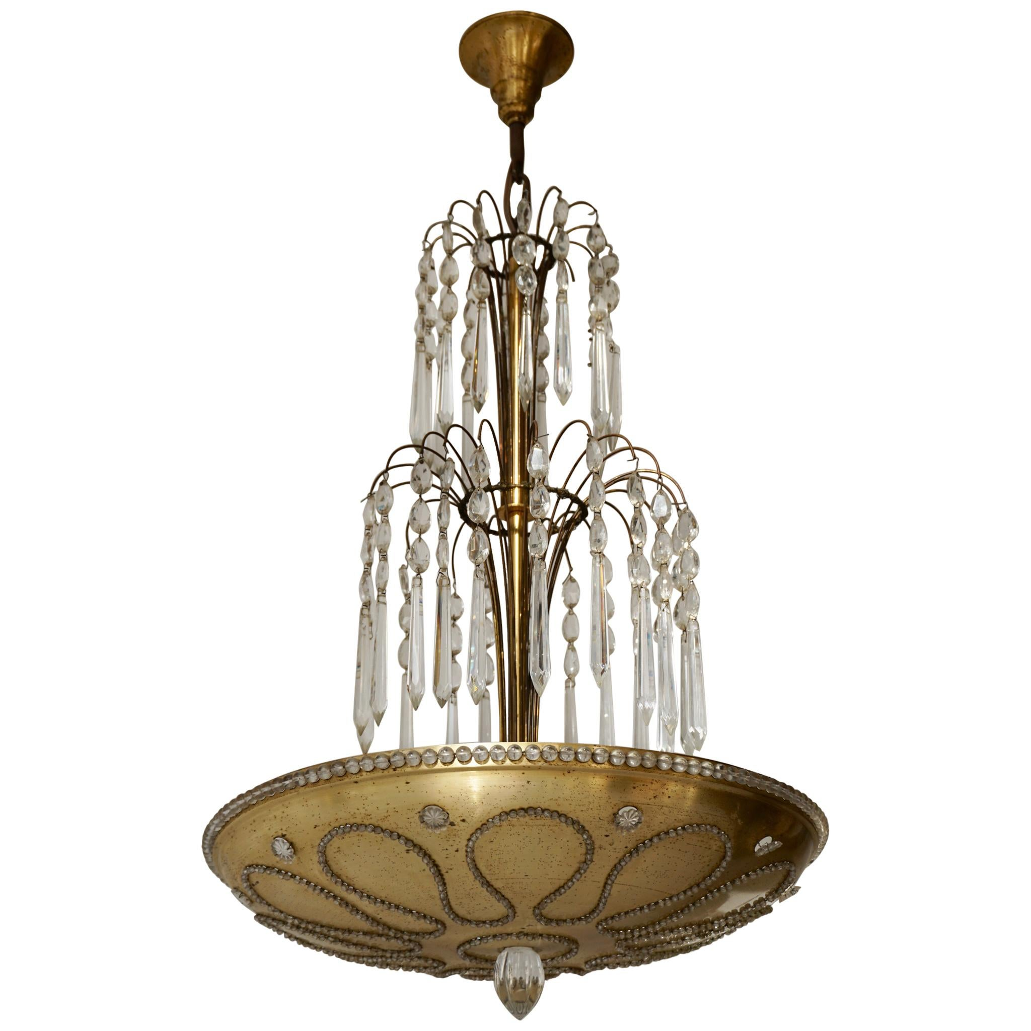 Chandelier in Gilded Metal and Crystal