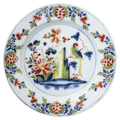 English Delftware Chargers with Parrot, Flowers Rock in Polychrome