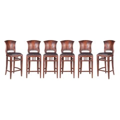 1980s Set of Eight French Leather Upholstered Wooden Stools