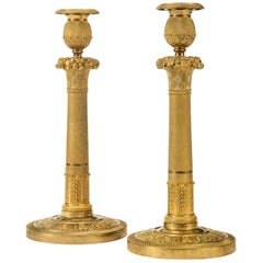 Pair of French Neoclassical Gilt Bronze Candlesticks