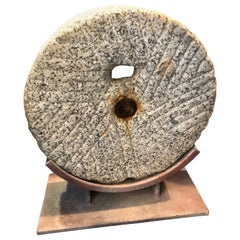 Primitive Grinding Stone Wheel on Iron Display