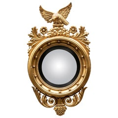 Antique Convex Mirror with Carved and Gilt Surround with Eagle Crest