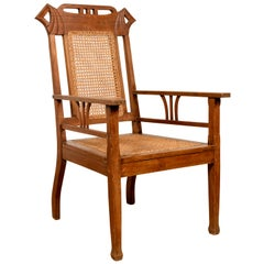 Vintage Indonesian Teak Wood Dutch Colonial Armchair with Rattan Seat and Back