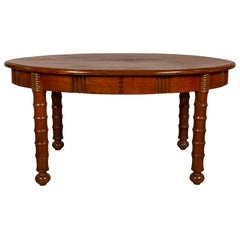 Antique Oval Dining Room Table from Indonesia with Spindle Legs and Warm Patina