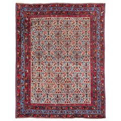 Antique Persian Afshar with a Floral Design in Red and Blue Color Tones