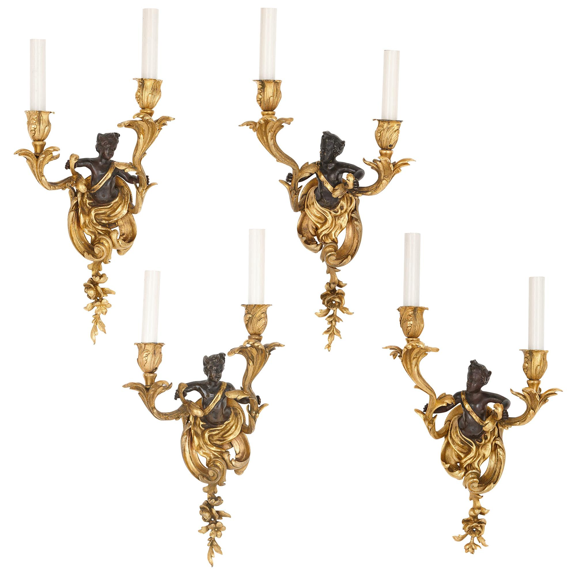 Set of Four Rococo Style Patinated and Gilt Bronze Sconces