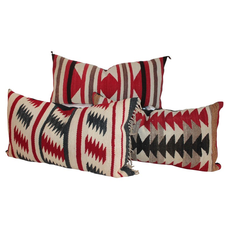 Collection of Three Navajo Saddle Blanket Bolster Pillows For Sale