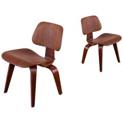 Pair of Early Walnut Eames DCWs Dining Chair Wood for Herman Miller