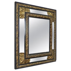 19th Century French Ebony Mirror with Gilt Repousse Brass