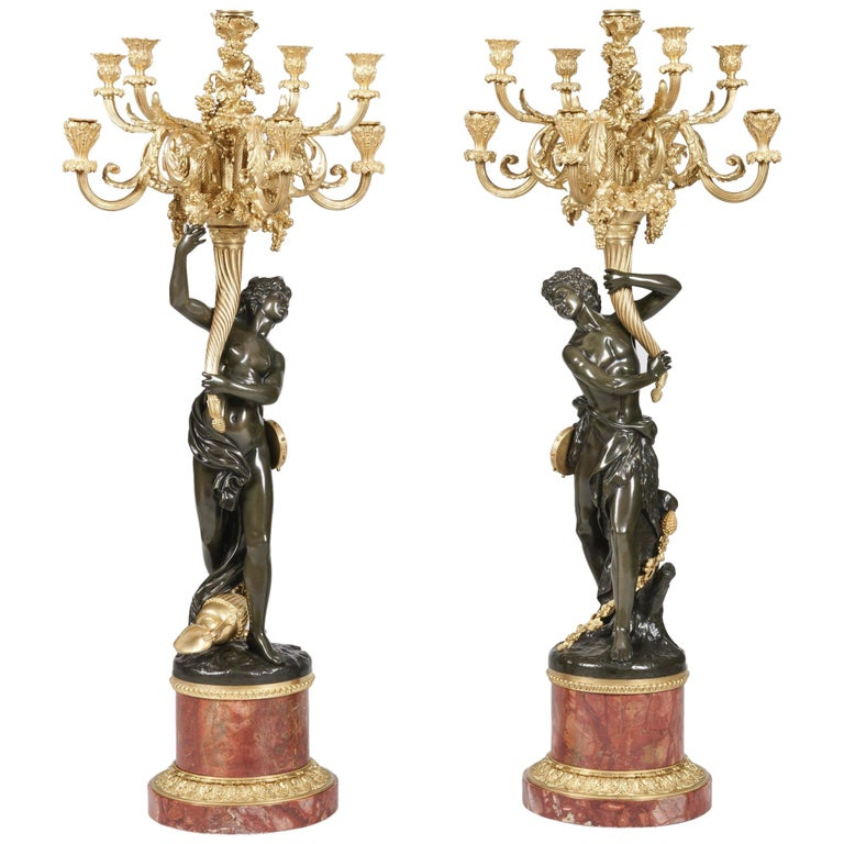 Pair of Large Bronze Candelabra after the Model by Clodion on Marble Bases For Sale