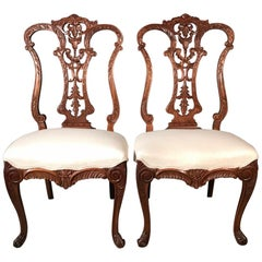 Pair of 19th Century Carved Side or Hall Chairs in Walnut with Linen Upholstery