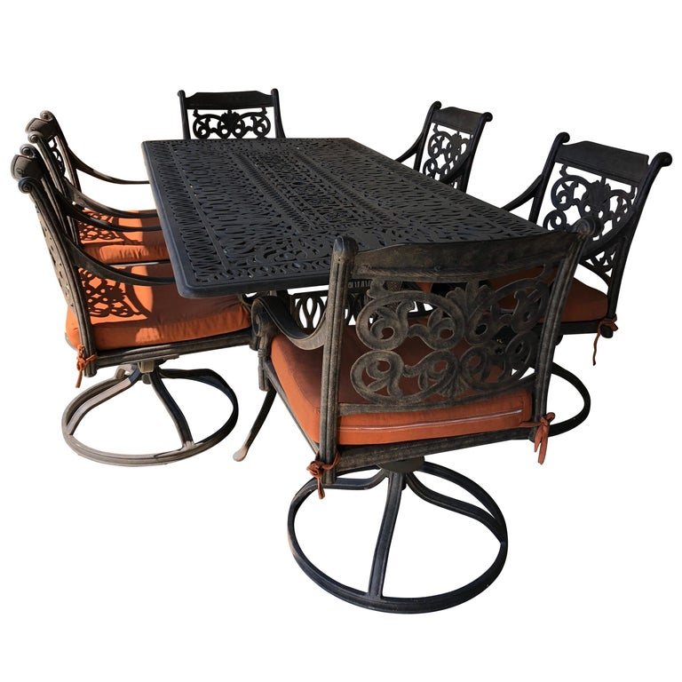 Let's Have a Party Large Cast Aluminum Patio Dining Table and 6 Armchairs For Sale