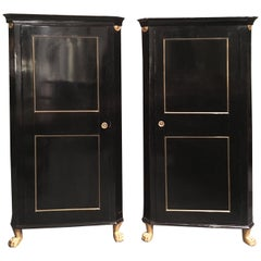 19th Century Italian Pair of Empire Corner Cabinets in Ebonized and Gilded Wood
