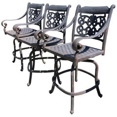 Trio of Handsome Large Outdoor Swivel Cast Aluminum Bar Stools for the Patio