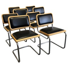 "Eight Black Marcel Breuer Style ""Cesca"" Chairs"