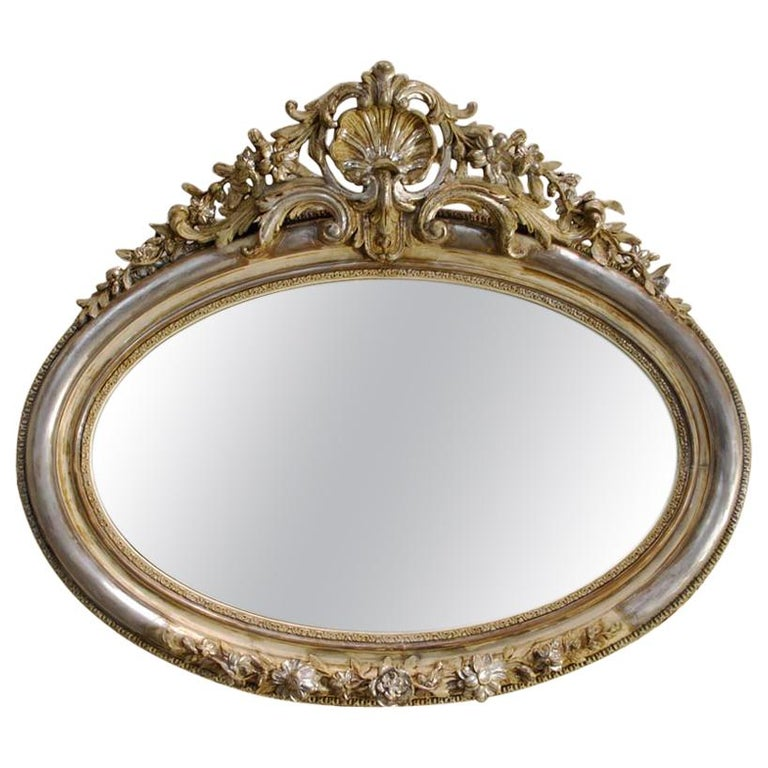 Antique 19th Century French Silver Leaf Gilt Oval Mirror with Crest For Sale