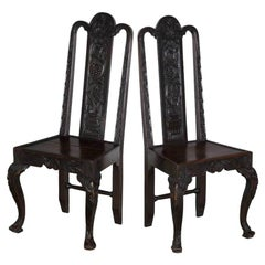 Pair of Victorian Dark Oak Hall Chairs with Intricate Carvings