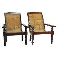 Pair of Anglo Indian Style 20th Century Mahogany and Cane Seat Plantation Chairs