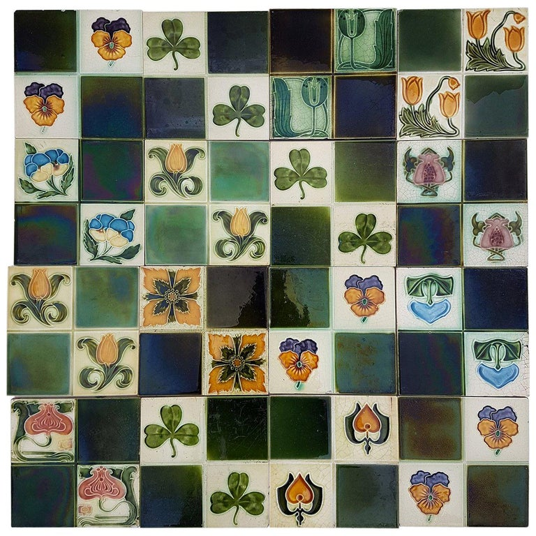 Panel of 16 Authentic Glazed Art Deco Relief Tiles, circa 1930s For Sale