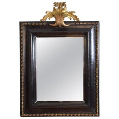 Italian Baroque Ebonized Walnut and Carved Giltwood Mirror, 17th or early 18thc.