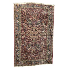 Antique Mashhad style hand knotted rug