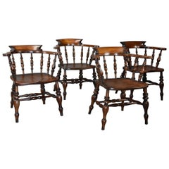 Set of Four Mid-19th Century Beech & Elm Smokers Bow Windsor or Captains Chairs