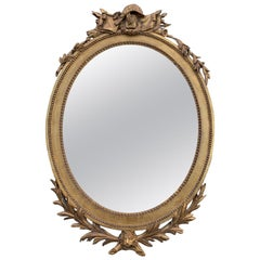 19th Century Continental Oval Giltwood Mirror with Trophy and Lion