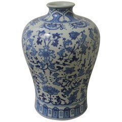 Large Blue, White Floral Chinese Porcelain Vase with Apocryphal Quinlong Mark