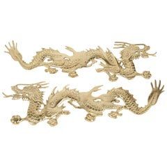 Large Pair of Asian Cast Brass Dragons Chasing a Ball Wall Mount