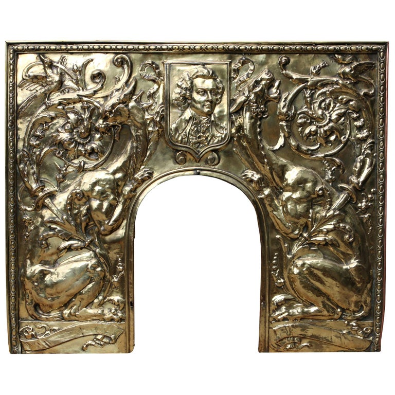 Antique Brass Repousse Fireplace Insert For Sale