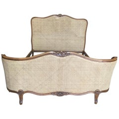 Romantic 1920s French Double-Caned and Walnut Bed Frame