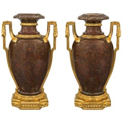 Pair of French Early 19th Century Louis XVI Style Porphyry and Ormolu Urns