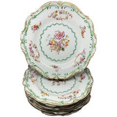 Set of Eight Green and Gilt Banded Floral Plates