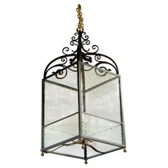 Wrought iron lantern with frosted panels to lower part