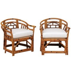 An Exquisite Pair of Horseshoe Back Rattan Club Chairs by McGuire, circa 1975