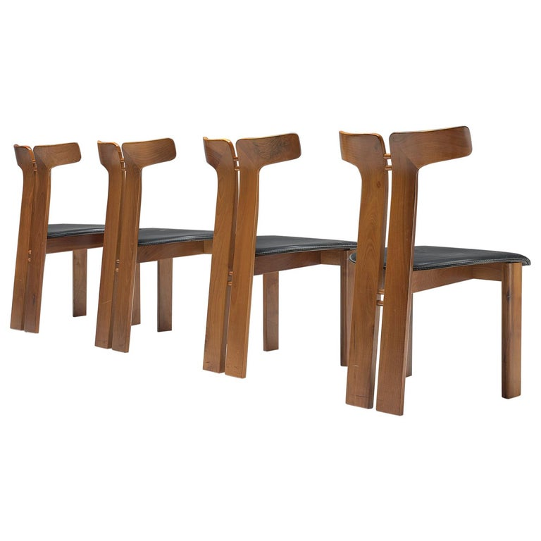 Set of four dining chairs in walnut and leather, 1980, offered by MORENTZ
