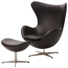"Arne Jacobsen ""The Egg Chair"" with Footstool in Dark Brown Leather"