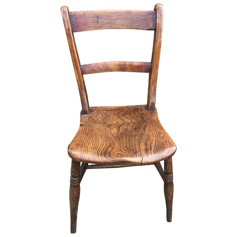 Harlequin Set Of Eight 19th Century Elm and Beech Windsor Bar Back Chairs For Sale