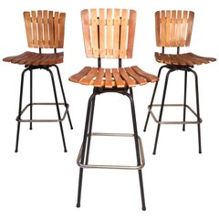 Set of Three Midcentury Slat-Back Swivel Bar Stools after Umanoff