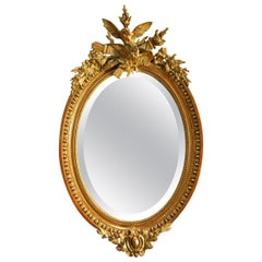 Antique 19th Century French Louis Seize Partially Gilt Oval Mirror with Crest