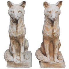 Pair of American Cast Stone Foxes Sitting on Squared Plinths, Circa 1880