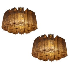 Set of Two Large Midcentury Chandeliers with Ice Glass Tubes in Brass Fixture