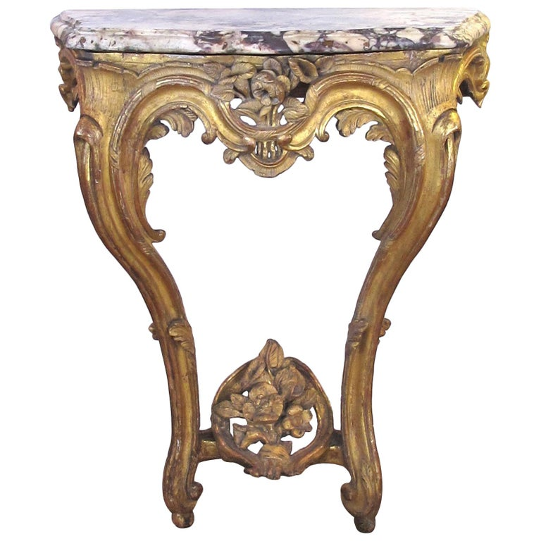 Well-Carved Italian Rococo Giltwood Wall Console with Calcutta Viola Marble Top For Sale
