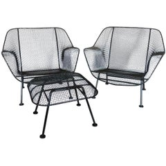 Pair of Properly Restored Black Woodard Wrought Iron with Mesh Lounge Chairs