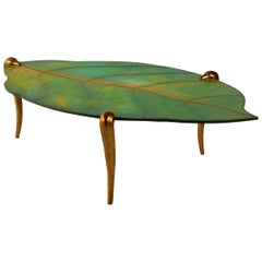 Coffee Table with Cast Alluminium Legs Gold Finish Hard Leather Top