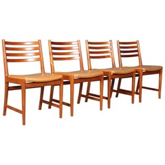 Kai Lyngfeldt Larsen four dining chairs, mahogany and original Vegetal leather.